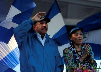 """Nicaraguan President Daniel Ortega and Vice President Rosario Murillo gesture during a march called """"We walk for peace and life. Justice"""" in Managua, Nicaragua, September 5, 2018. Picture taken September 5, 2018. REUTERS/Oswaldo Rivas"""