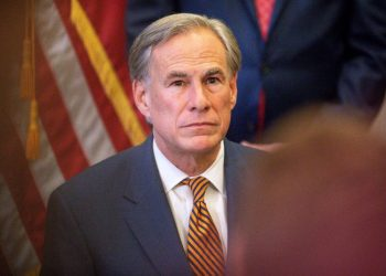 """(FILES) In this file photo taken on June 8, 2021 Texas Governor Greg Abbott attends a press conference where he signed Senate Bills 2 and 3 at the Capitol in Austin, Texas. – The Republican governor of Texas, who has been a forceful opponent of mask mandates, has tested positive for Covid-19, his office said Tuesday, one day after attending an indoor public event. Greg Abbott, who is fully vaccinated, """"has been testing daily, and today was the first positive test result,"""" said a statement from his spokesman Mark Miner. (Photo by Montinique Monroe / GETTY IMAGES NORTH AMERICA / AFP)"""
