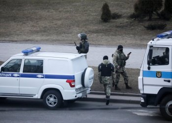 Police officers are seen in Minsk, Belarus, on March 25, 2021. Belarusian authorities today raided news outlets throughout the country and arrested journalists. (BelaPAN via AP)