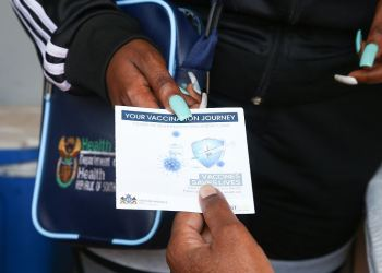 A COVID-19 vaccination card pictured at a vaccination site at Itsoseng Sports Ground on September 04, 2021 in Cosmo City, South Africa. (Photo by Luba Lesolle/Gallo Images via Getty Images)