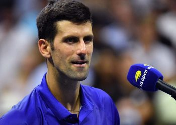 Serbia's Novak Djokovic speaks on the court after winning his 2021 US Open Tennis tournament men's singles first round match against Denmark's Holger Rune at the USTA Billie Jean King National Tennis Center in New York, on August 31, 2021. (Photo by ANGELA WEISS / AFP)