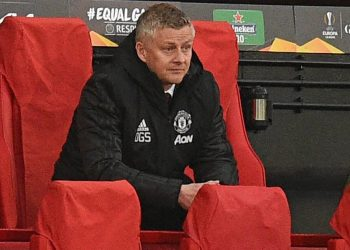 Manchester United's Norwegian manager Ole Gunnar Solskjaer watches from his seat during the UEFA Europa league quarter final, second leg football match between Manchester United and Granada at Old Trafford stadium in Manchester, north west England, on April 15, 2021. (Photo by Oli SCARFF / AFP)