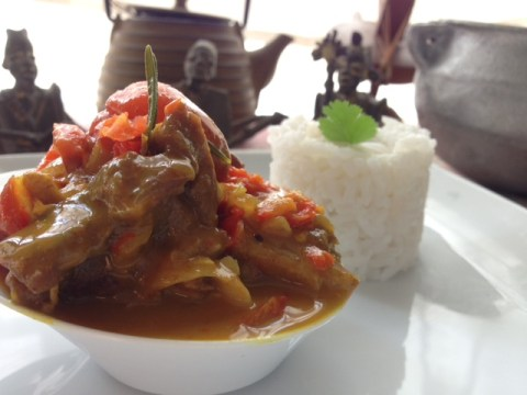 spicy curried goat and tuwo rice hausa nigerian food