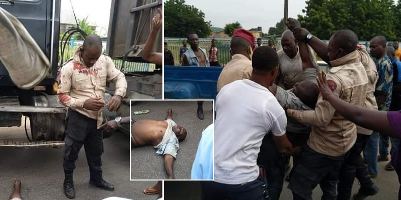 PHOTOS: Angry mob pounce on FRSC official in Delta for allegedly pushing driver off his truck