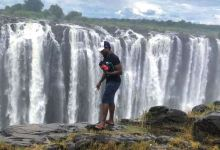 Tourist pictured near edge of Victoria Falls in Zimbabwe seconds before he fell 350 feet to his death
