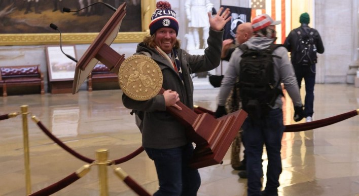 Capitol rioter seen carrying off Nancy Pelosi's lectern in viral photo has been arrested