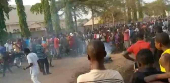 PHOTOS: Angry mob set young man ablaze for allegedly stealing N2000 in Benue