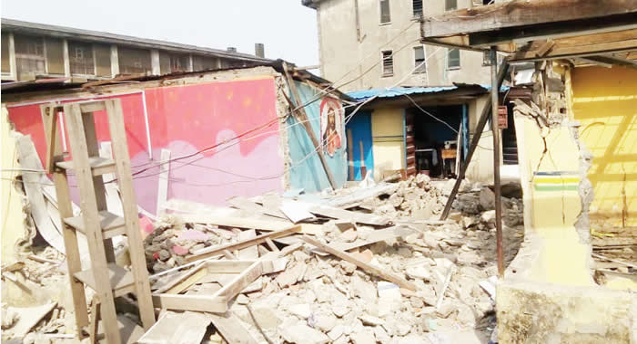 Mother of three slumps as POWA demolishes shops in Lagos market