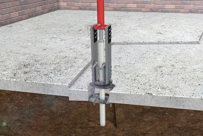 Installing steel tubes on slab pier repair