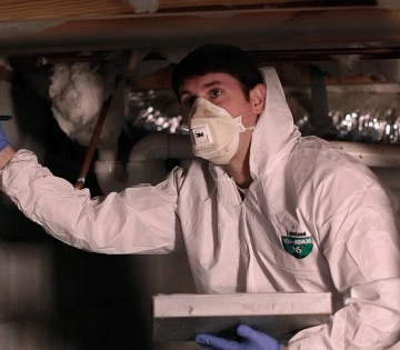 Inspector in crawl space