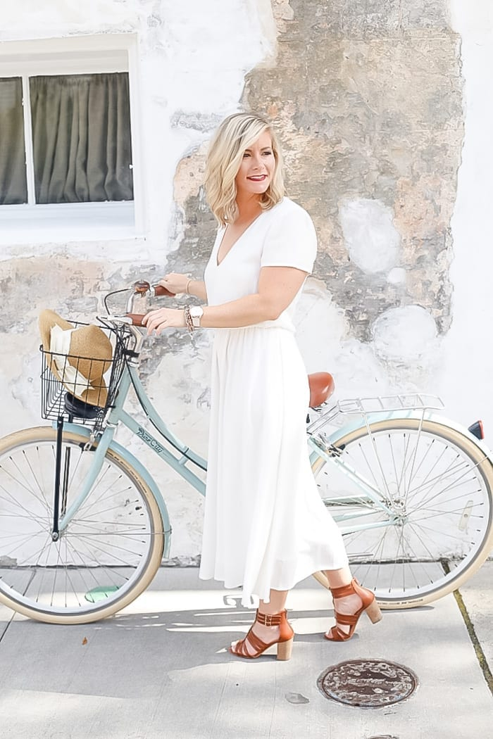 Blogger from Afternoon Espresso, Ashley Pletcher wears a Wayf white dress to explore Charleston