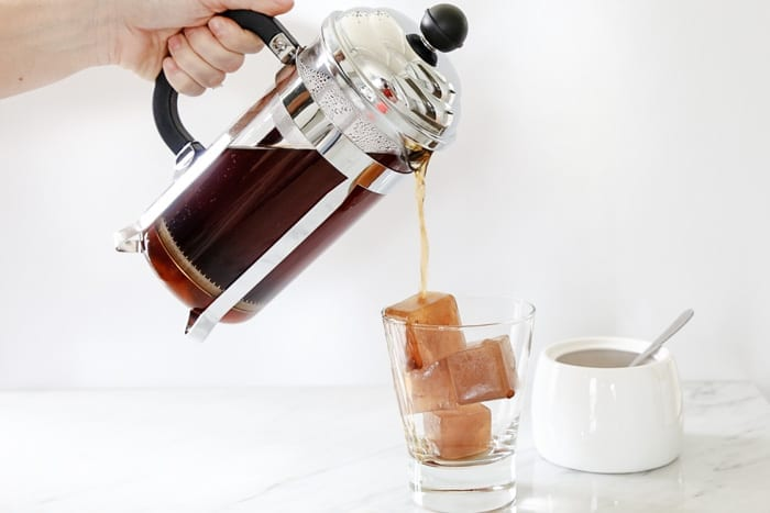 Blogger, Ashley Pletcher of Afternoon Espresso preps her frozen coffee ice cubes for her Fresh Vanilla Iced Lavender Coffee Recipe-4