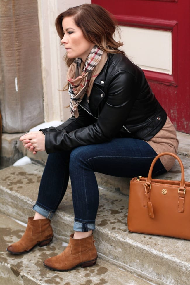 Blogger, Ashley Pletcher shows off another fall look with a Forever 21 leather jacket layered with an Old Navy cardigan, Dolve Vita booties, and a Tory Burch Robinson tote.
