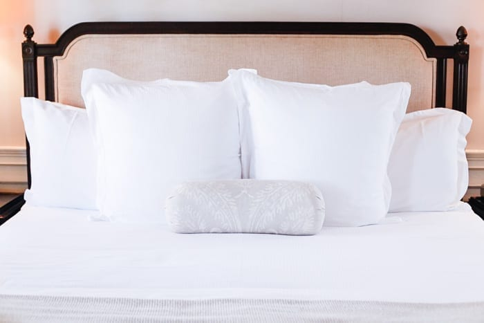 Blogger Ashley Pletcher enjoyed the luxurious, plush bedding at Zero George, a luxury boutique hotel during her stay in