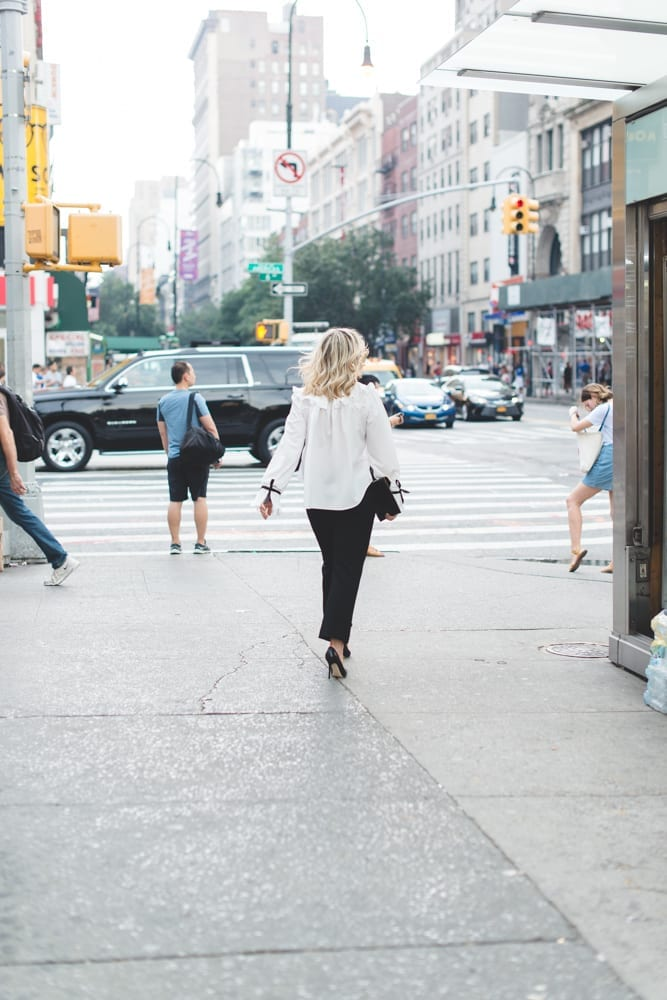 Blogger of Afternoon Espresso, Ashley Pletcher heads to her next NYFW show wearing an Asos blouse, Express pants, and Jimmy choo pumps!