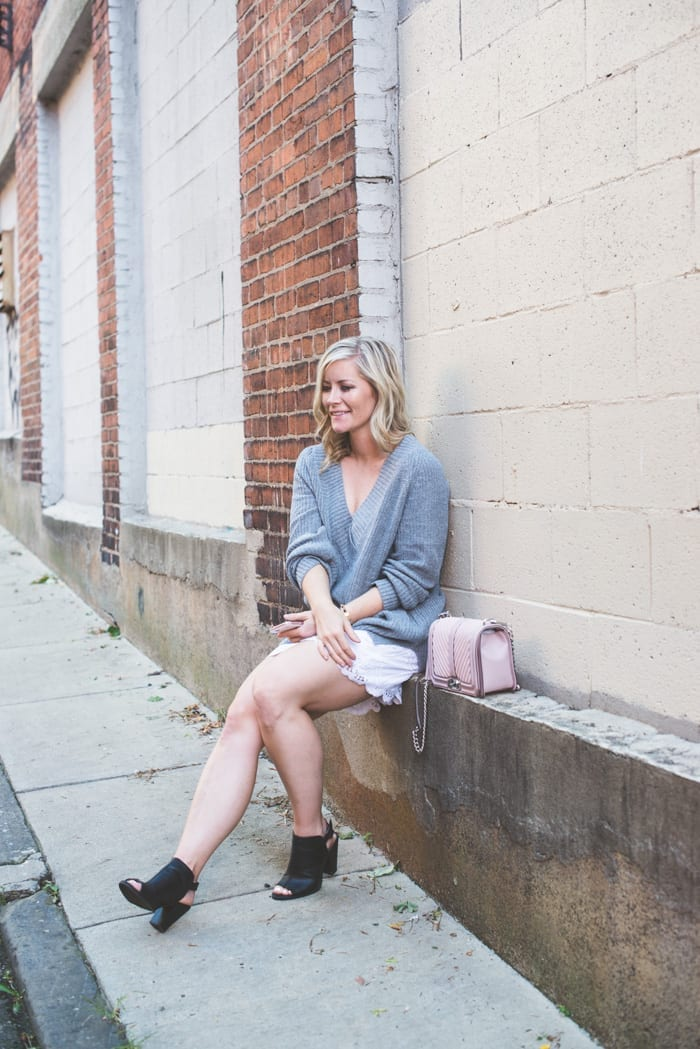 Fashion Blogger, Ashley Pletcher starts transitioning clothing into a Fall wardrobe by pairing an Abercrombie & Fitch summer skirt with some black booties and a Nordstrom deep v-neck sweater.