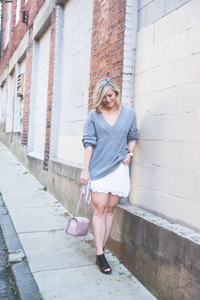 Fashion Blogger, Ashley Pletcher starts transitioning her outfits into Fall by layering a Nordstrom sweater with an Abercrombie and Fitch skirt.