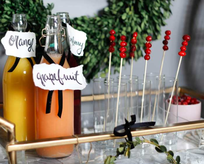 Spreading Christmas cheer with a variety of juices for a mimosa bar!