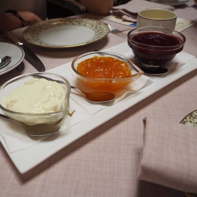 Strawberry preserve, Orange marmalade and Cream.