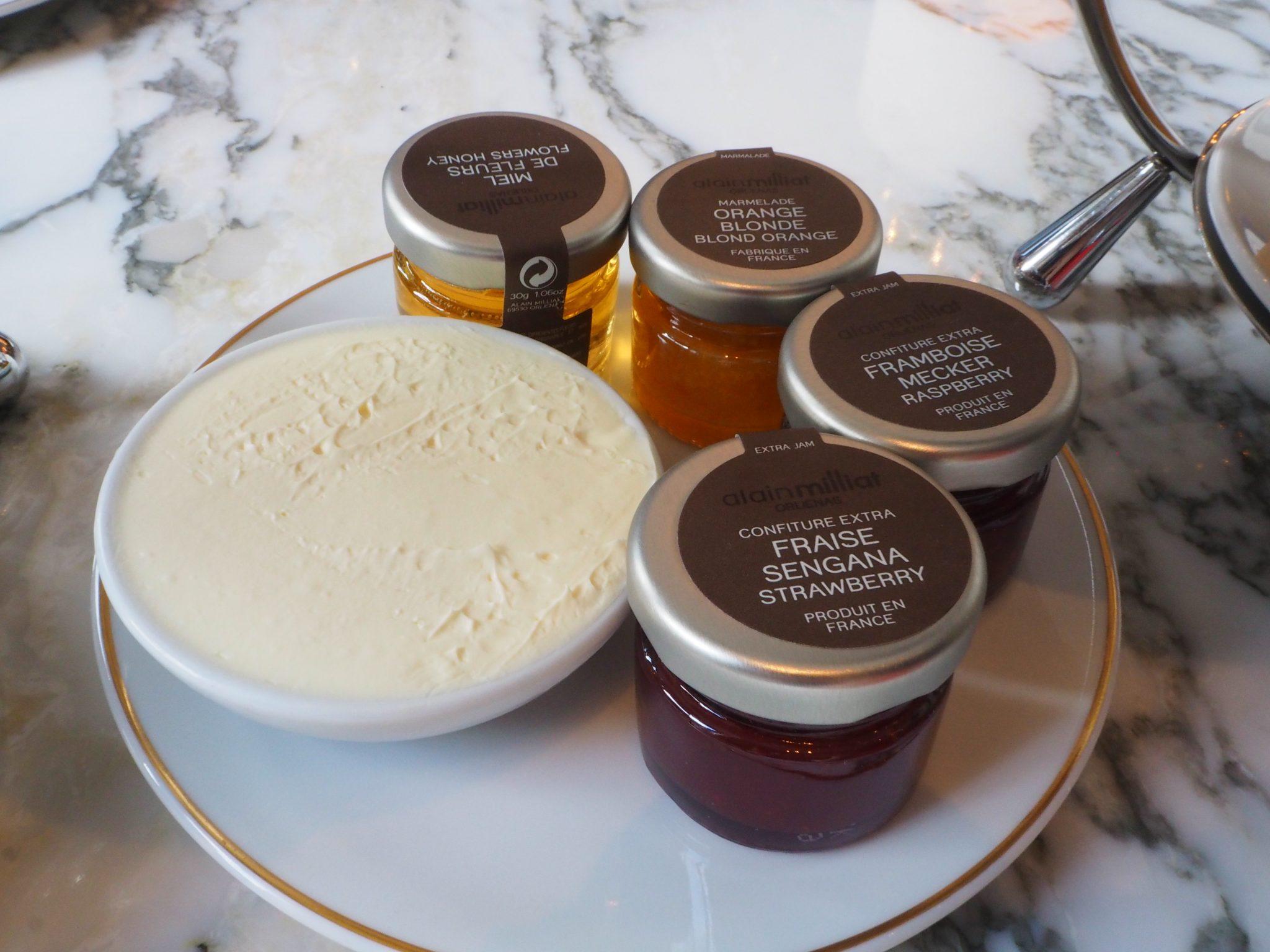 Clotted cream, Raspberry, strawberry & marmalade jam and Honey.