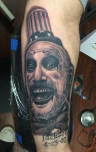 Horror tattoo, portrait tattoo, black and grey, captain spaulding