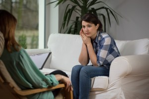 Young woman talking to counselor