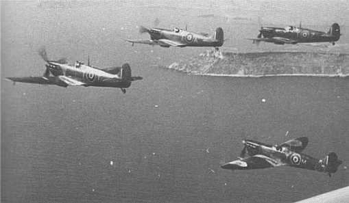 This photo clearly shows the differences in Malta Spitfires, even among four from the same squadron. Note the presence of clipped and standard wingtips, volkes filters on some, and not on others, different paint schemes, and even different coloring on the upper wing roundels.