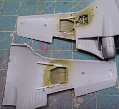 Plastic strips (1.5mm x 1mm) were set in place in the outer wing parts, and then joined to the inner wing area. A small strip of plastic was also added in the wing fold gap and painted the wheel well color.