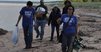 Dr. Lorena Rios Mendoza leads students in a yearly beach cleanup.