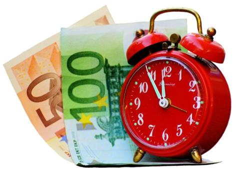 Time is money. (Clock and bills.)