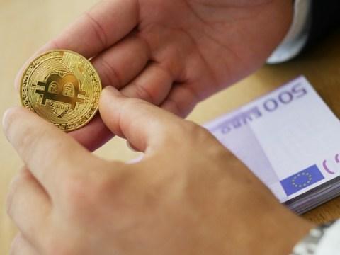 Euro banknotes and Bitcoin commemorative coin