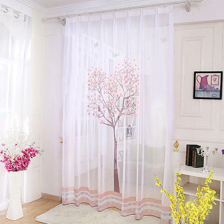 une paire de voilages blanc motif arbre