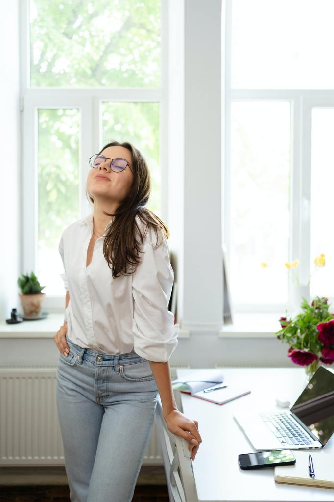 Businesswoman sitting at home and managing her business via home office