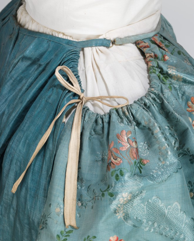 Blue Robe à la Française at The Metropolitan Museum of Art showing construction details of petticoat.