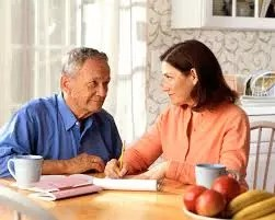 man and woman discussing financial benefits