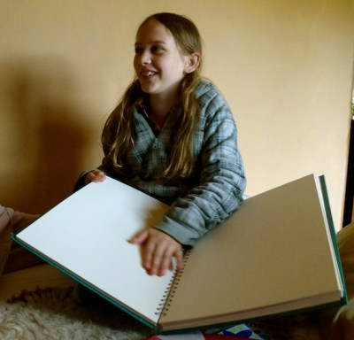 Agi K with huge sketchbook for her 10th birthday