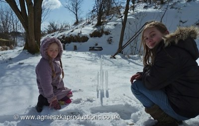 Agi K & Magdalena making ice scultures in the snow