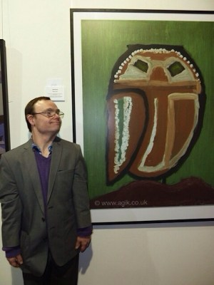 Christopher Lodge infront of his work at The Reveal, Menier Gallery
