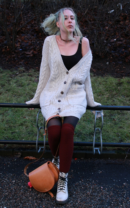 white sweater and red socks