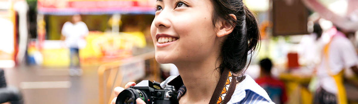 Girl sightseeing with camera