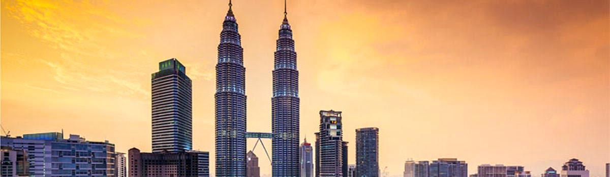Petronas Towers view at sunset in Kuala Lumpur, Malaysia