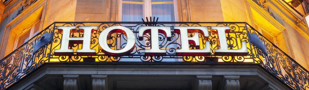 Cheap hotels in Paris- Featured photo (1200x350) a hotel sign in Paris