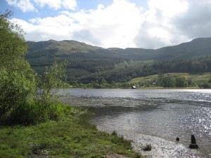 as the factor to enact God's New Testament economy, Christ replaced all the sacrifices with Himself [picture: a lake in Scotland]