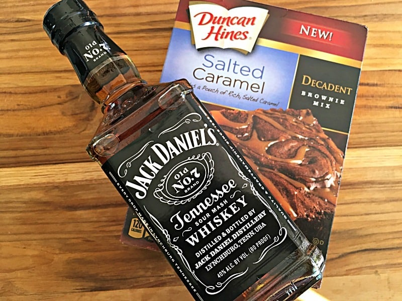 Boozy Brownies ~ fudgy, moist brownies topped with a salted caramel Jack Daniels laced topping. A hit at every party and a touchdown at your next tailgate.