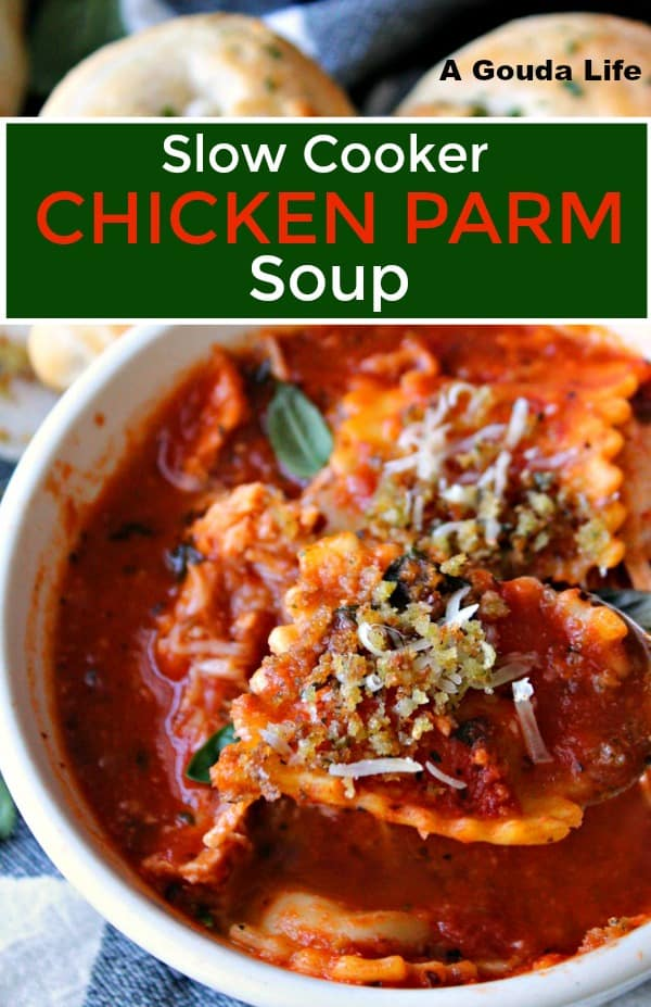 Bowl of Slow cooker Chicken Parm Soup topped with crispy breadcrumbs served with butter garlic knots