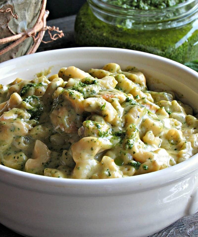 bowl of pesto pasta with jar of pesto nearby