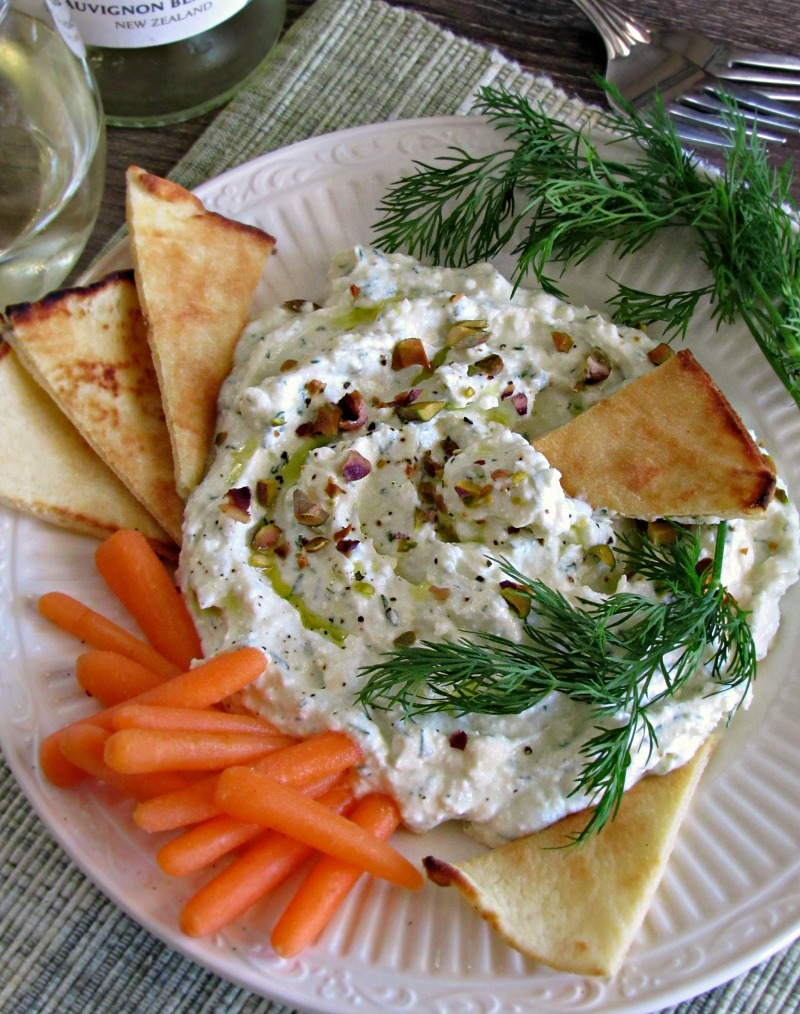 Garlic Feta Dip ~ loaded with the bold Mediterranean flavors of garlic and feta, balanced with fresh lemon and dill in a creamy dip. Serve with warm toasted pita and veggies.