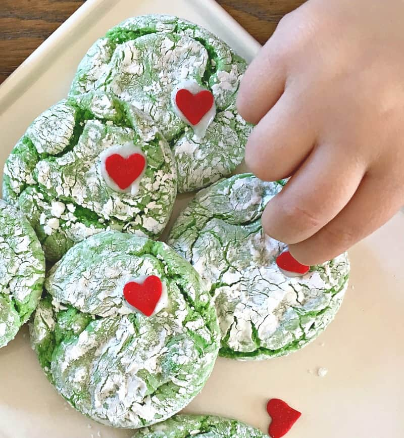 white plate with green cookies with red heart