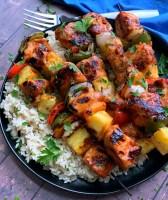 plate of hawaiian chicken kabobs and rice