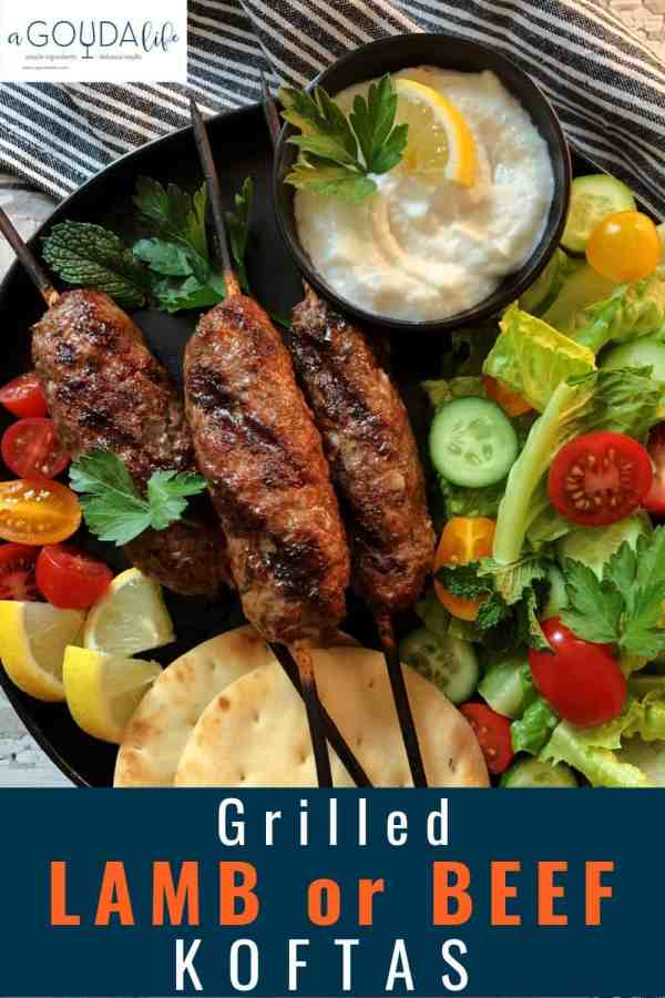 pinterest pin showing black plate with 3 kofta kabobs, naan bread and tzatziki